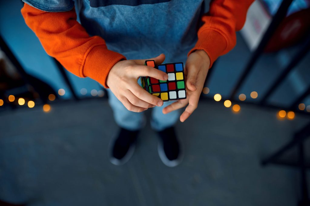 kid holding puzzle cube